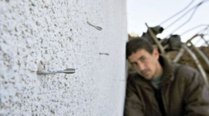 This picture shows   darts from an Israeli  flechette shell embedded in a wall in Gaza.